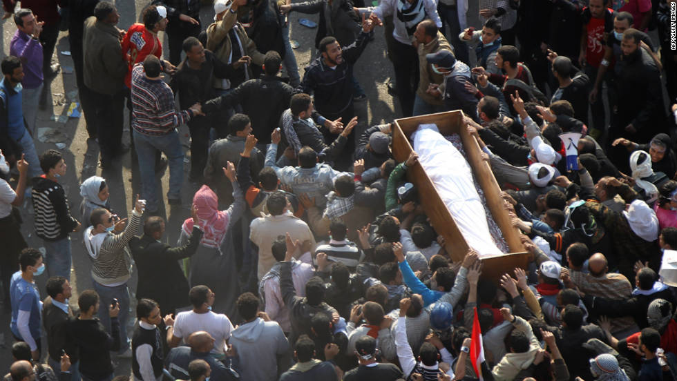 Egyptians protesters attend a funeral of a victim supposedly killed during clashes with Egyptian police in Tahrir Square on November 22, 2011.