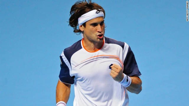 David Ferrer celebrates his stunning stright sets victory over Novak Djokovic in London.