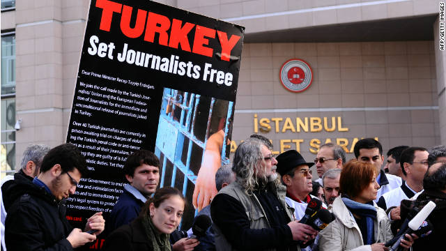 Journalists and human right activists protest in front of the courthouse in Istanbul during the trial of several journalists.