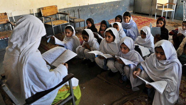 A female teacher gives a lesson at a girl's school in the main town of Swat valley, Pakistan on August 1, 2009.