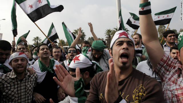 Pro-reform supporters protest outside the Arab League headquarters in the Egyptian capital Cairo on November 24, 2011.