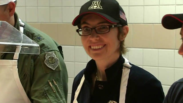 Rep. Gabrielle Giffords serves troops