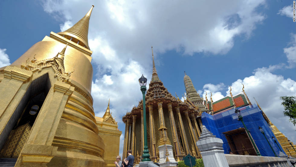 Tourists take pictures at the Temple of the Emerald Buddha in the Thai capital, Bangkok. Thailand has long been one of the most popular tourist destinations in Southeast Asia with the Tourism Authority of Thailand expecting 19.1 million visitors in 2011 alone.
