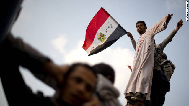 A protester waves his national flag during a rally at Tahrir Square on Thursday. Protesters demanded an end to military rule.