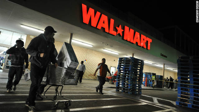 Signs of slowing momentum before the crucial end-of-year holiday shopping season sent Walmart shares down