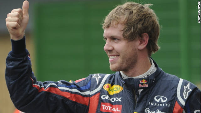 World champion Sebastian Vettel celebrates winning his record 15th pole position this season at Interlagos on Saturday.