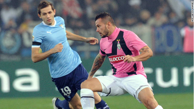 Juventus' match-winner Simone Pepe, right, holds off Lazio's Senad Lulic at the Olympic stadium in Rome.