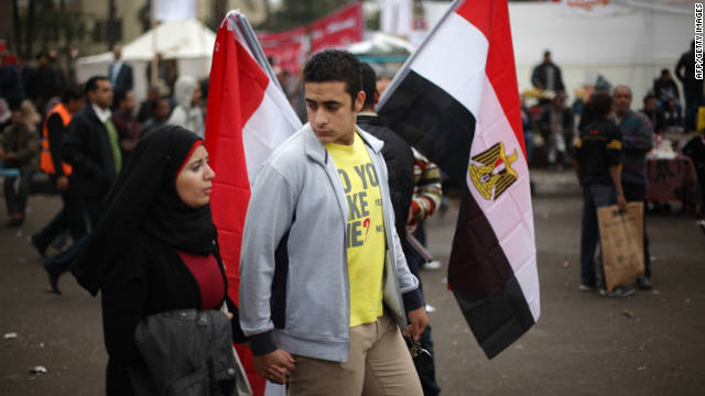A couple walk in Cairo's Tahrir Square, where protesters continue to camp ahead of elections, on November 27.