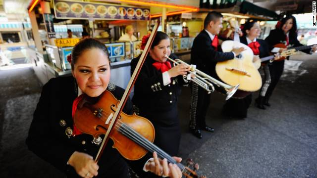 Members of the Mariachi band, Ellas Son, perform during Cinco de Mayo festivities on May 5, 2011, in Los Angeles.