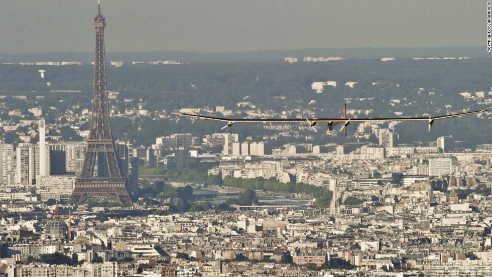 The Solar Impulse soars high above the streets of Paris in 2012.