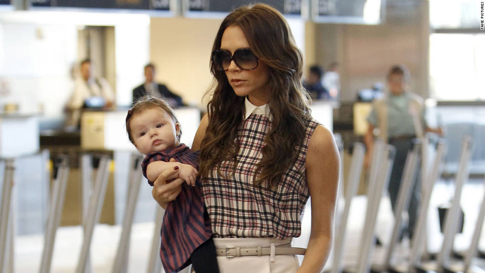 Victoria Beckham and her daughter Harper catch a flight from Los Angeles.