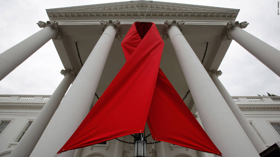 A red ribbon is hung between columns on the north side of the White House to commemorate World AIDS Day on November 30, 2010, in Washington.