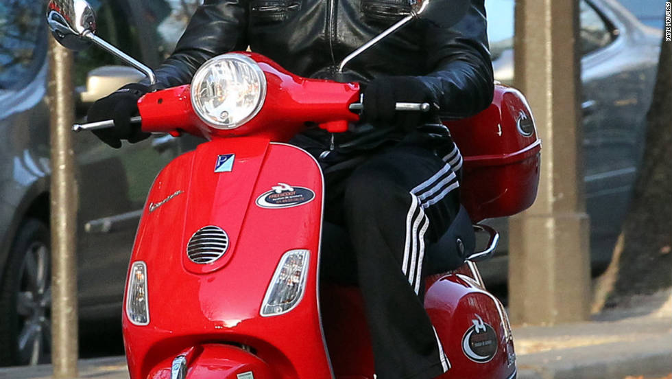 Bradley Cooper rides a Vespa to the gym in Paris.