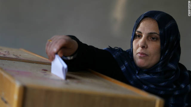 A woman places her vote in the ballot box at a polling station in the Shubra district of Cairo on the second day of voting on November 29, 2011.