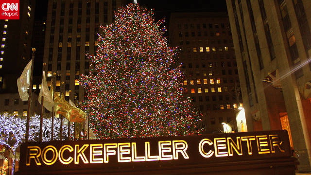 Early in the morning of the first day of December, the 2011 Rockefeller CenterChristmas Tree is at the center of it all, shining bright.