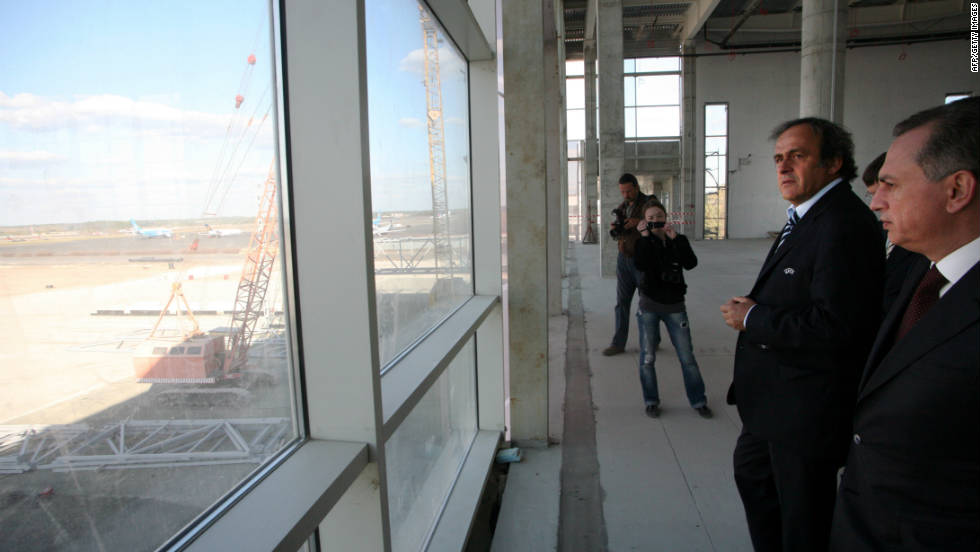 Platini and deputy prime minister Boris Kolesnikov inspect work on a new terminal at Donetsk airport. The improvement work, insisted on by European football's governing body, comes at a cost of $412m, according to the Ukrainian government.