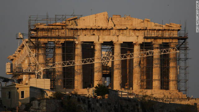 Scaffolding surrounds the Acropolis as the sun drops in the sky on June 1, 2011 in Athens, Greece.