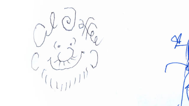 Al Jaffee signed a copy of a collection of Mad art with his self-caricature.