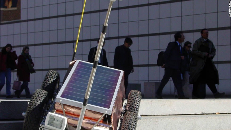 "The ""Afghan Explorer"" is a solar-powered mobile robot developed by the Massachusetts Institute of Technology. The device was designed to practice elements of journalistic reporting in hostile or off-limits environments at the beginning of the Afghan war. Despite a flurry of newspaper coverage when it was first revealed, few editors have sent cyborg reporters to cover the world's conflict hot spots."