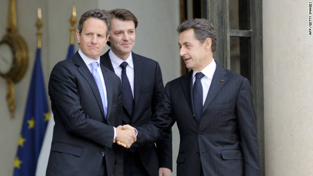 France's President Nicolas Sarkozy (R) shakes hands with US Treasury Secretary Timothy Geithner (L)  at the presidential Elysee palace in Paris.