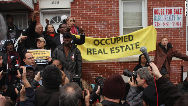 Members of the Occupy Wall Street movement rally around a foreclosed home during a march in East New York earlier this week.