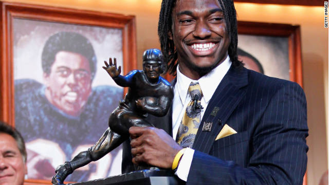 In this handout provided by the Heisman Trophy Trust, Robert Griffin III of the Baylor Bears poses with the trophy.