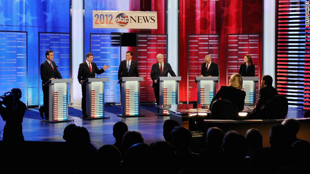 Rick Santorum, from left, Rick Perry, Mitt Romney, Newt Gingrich, Ron Paul and Michele Bachmann debate in Iowa on Saturday.