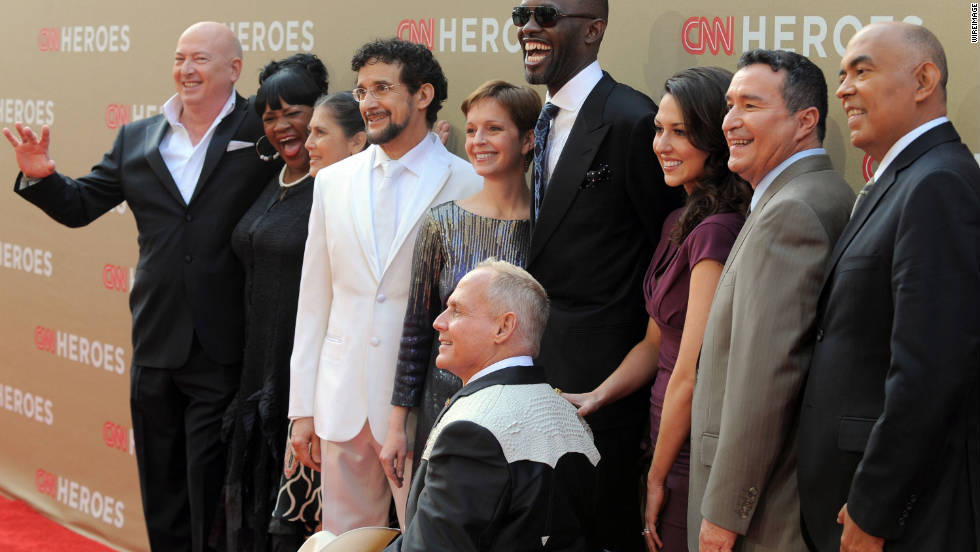 The top ten CNN Heroes gather for photos on the red carpet at The Shrine Auditorium for 2011 CNN Heroes: An All-Star Tribute on Sunday, December 11.