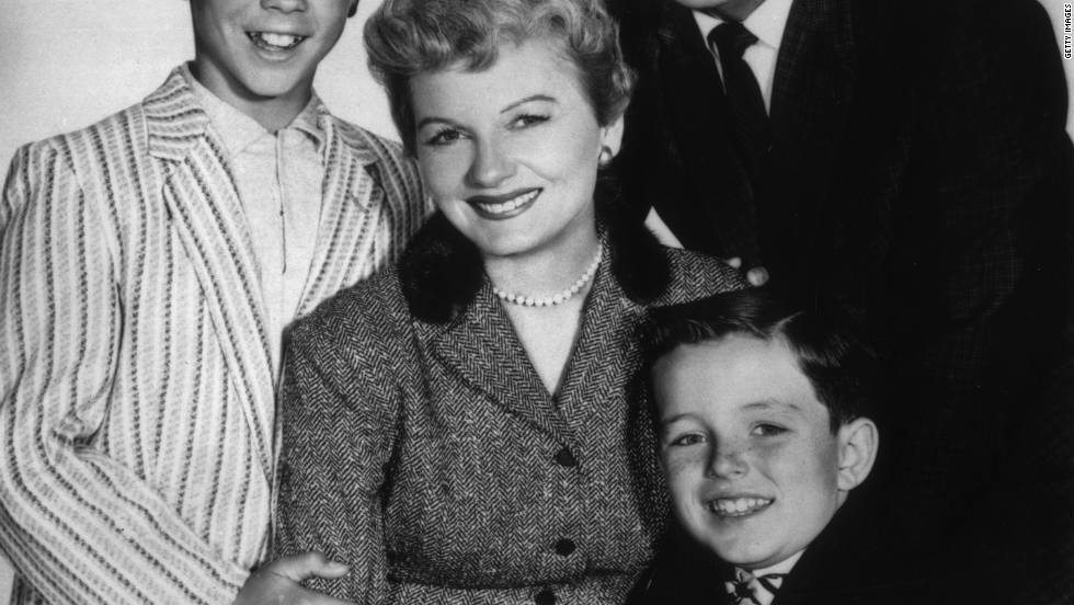 "The story of the family Cleaver -- along with ""Father Knows Best"" and ""The Donna Reed Show"" --  debuted in the 1950s. The shows presented a suburbia of cheerful working fathers, pearl-and-apron-bedecked mothers and mischievous children, all living in happy modern towns away from the city."