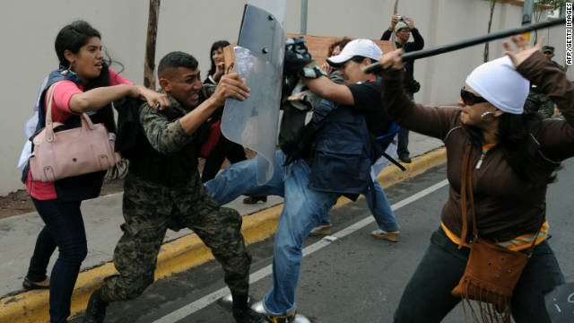 Honduran soldier clashes with demonstrators  protesting against the murder of colleagues, in Tegucigalpa