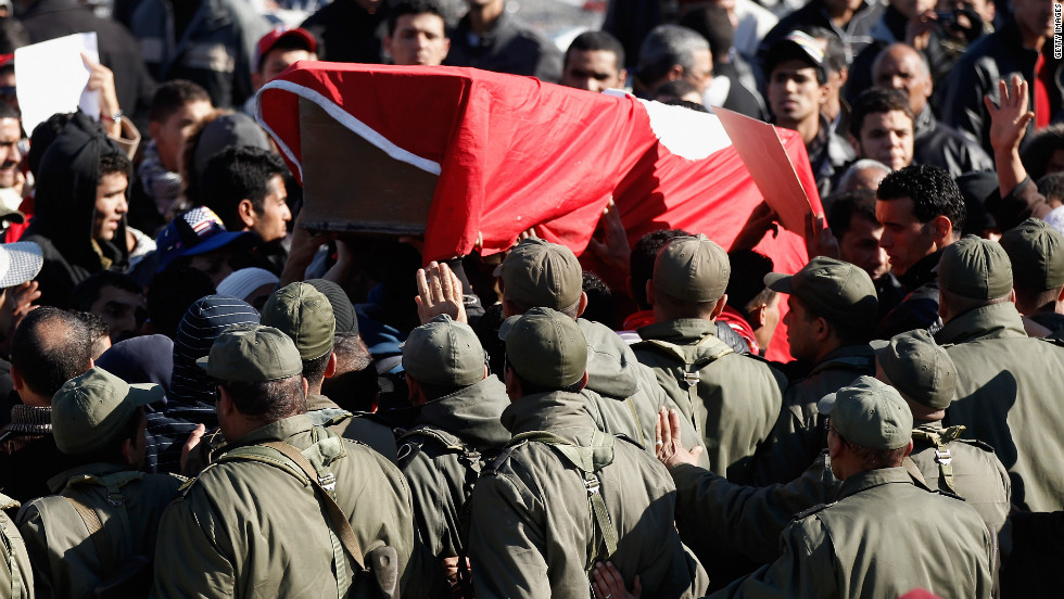 Protesters carry a coffin draped in the Tunisian flag representing martyr Mohamed Bouazizi on January 24, 2011 in Tunis, Tunisia.