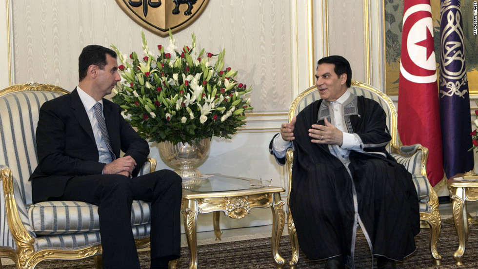 Former Tunisian President Zine El-Abidine Ben Ali (R) talks with Syrian President Bashar al- Al Assad (L) in Tunis on July 12, 2010.  After three weeks of violent protests over rising unemployment rates, poverty levels, inflation and government repression, Ben Ali fleed the country for Saudi Arabia on January 14.