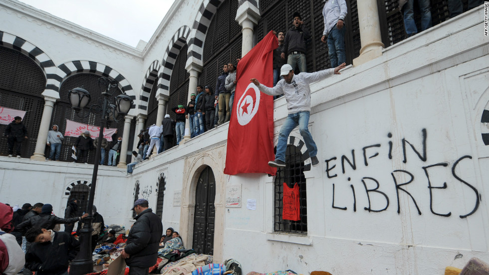 Inhabitants of the central Tunisia region of Sidi Bouzid who slept overnight near the office of the Tunisian Prime Minister in Tunis on January 24, 2011 call for the government to resign.