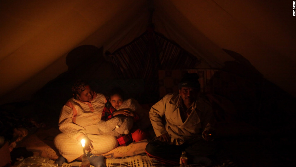 A Somali family sit in a tent at a United Nations displacement camp on March 11, 2011 in Ras Jdir, Tunisia. Tens of thousands of guest workers from Egypt, Tunisia, Bangladesh, Sudan and other countries fled to the Tunisian border to escape fighting in and around the Libyan capital of Tripoli.