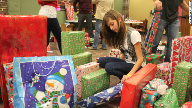 Volunteers handed out the donated presents to every child who attended the Kids House Christmas party.