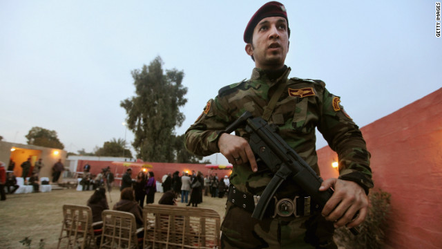 An Iraqi Army special forces soldier keeps watch at a women's art exhibition in Baghdad on December 14.
