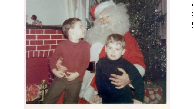 "Michael Rielly, left, knew one Santa when he was growing up. But it would be years before he knew it was his ""Papa."""