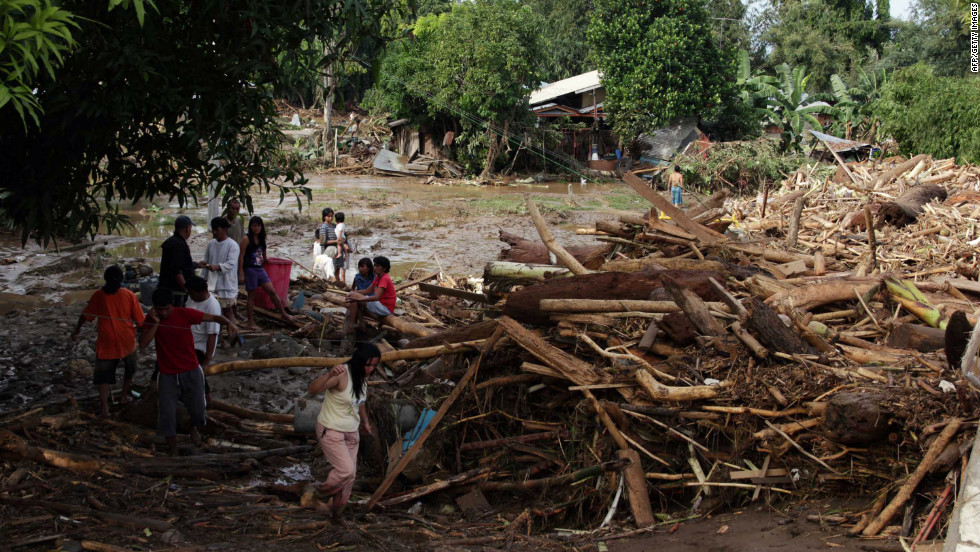 Residents of Iligan City, in the southern Philippines, examine piles of debris after the storm.
