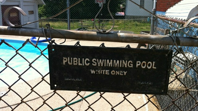 Michael Gunn says he tried to keep his bi-racial daughter from hearing about the sign that appeared after she swam at a pool.