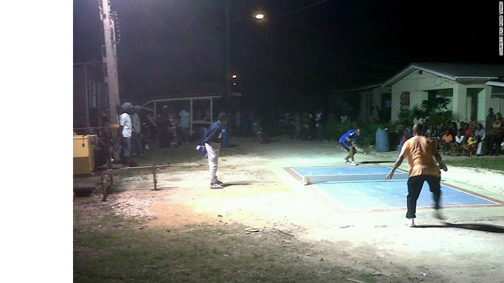 Improvised floodlights are used to make sure road tennis can be played in any setting and at any time in Barbados.