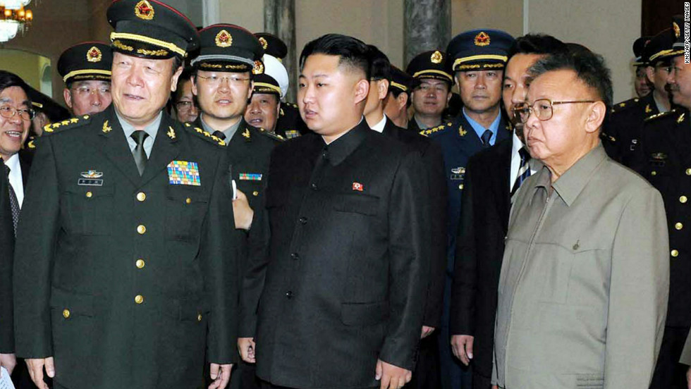 North Korean leader Kim Jong Il, right, and his son Kim Jong Un meet with a group of Chinese officers during a visit to Pyongyang in October, 2010. Reports begin to surface that Kim Jong Il will name his third and youngest son, Kim Jong Un, as his successor.