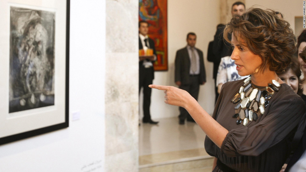 Asma al-Assad attends the opening of the Syrian abstract art exhibition in Damascus on July 21, 2008.