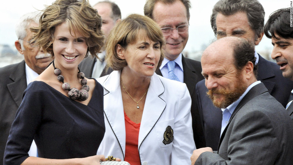 Asma al-Assad, left, chats with French Culture Minister Christine Albanel and Syrian artist Mustafa Ali on July 12, 2008, in Paris.