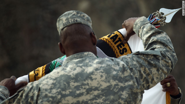 Army Gen. Lloyd J. Austin III returns the United States Forces-Iraq command flag to U.S. soil on Tuesday.