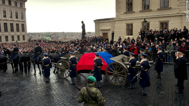 Crowds watch as the coffin of former President Vaclav Havel is brought to Prague Castle ahead of his state funeral.