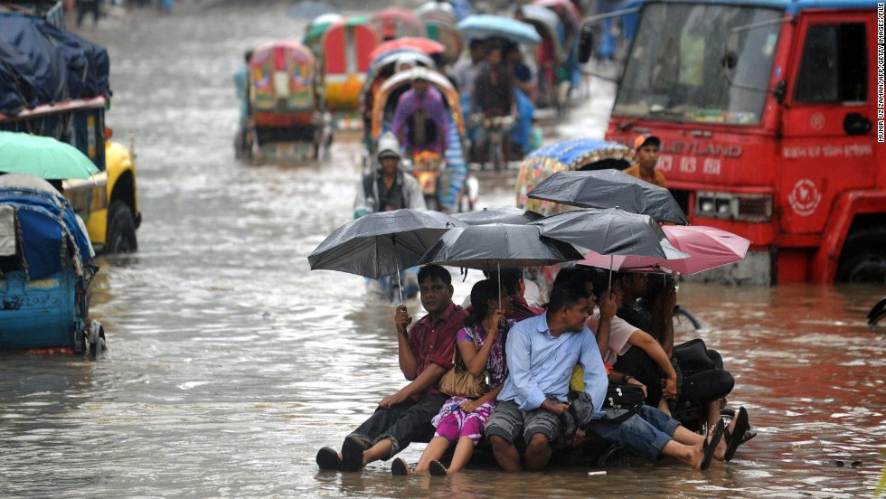 Bangladeshis attempt to stay dry above flood waters in the capital, Dhaka. Bangladesh was ranked by Maplecroft the country most vulnerable to climate change, and Dhaka the world's most vulnerable city, due to its exposure to threats such as flooding, storm surge, cyclones and landslides, its susceptible population and weak institutional capacity to address the problem.
