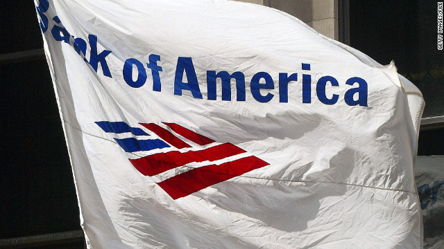 CHICAGO - APRIL 6: A Bank of America flag flies outside its building April 6, 2004 in Chicago. Charlotte, North Carolina-based Bank of America has said it will cut 12,500 jobs after its recent merger with FleetBoston Financial Corp. (Photo by Tim Boyle/Getty Images)