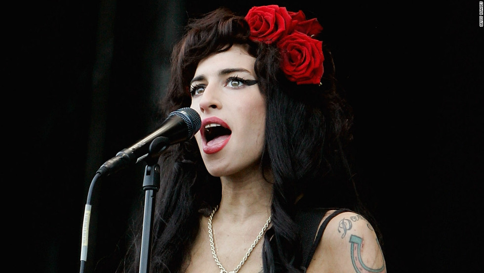 "Singer Amy Winehouse was found dead July 23 in her London apartment. The 27-year-old performer infamous for her arrests and substance abuse problems died of alcohol poisoning. <a href=""http://articles.cnn.com/2011-07-23/entertainment/amy.winehouse.dies_1_drug-overdoses-winehouse-spokesman-chris-goodman-singer-amy-winehouse?_s=PM:SHOWBIZ"">Full story</a>"