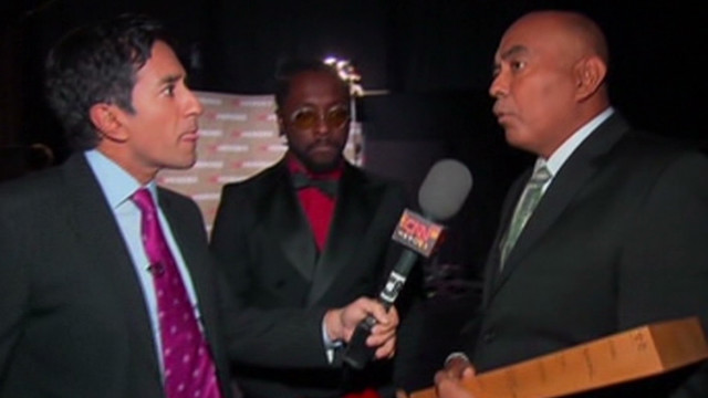 Dr. Sanjay Gupta interviews CNN Hero Patrice Millet and presenter Will.I.Am backstage at the 2011 Heroes tribute in Los Anglese