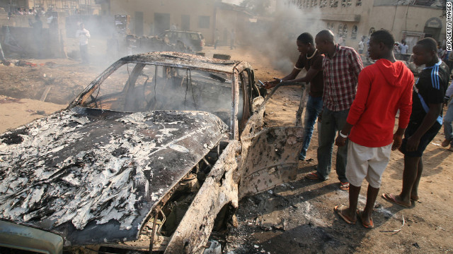 The devastating scene outside St Theresa Catholic Church near the Nigerian capital Abuja on Sunday.